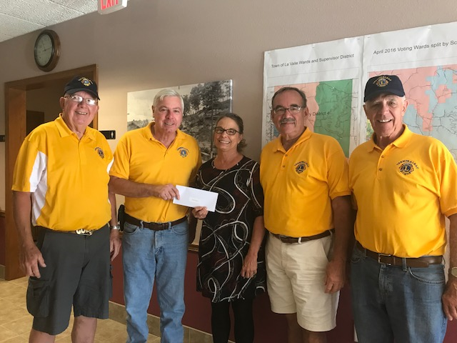 Lions delivering a Flood Raiser check in LaValle, WI